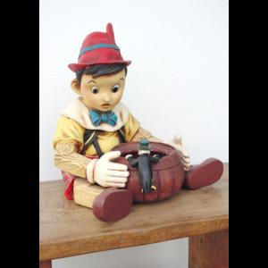 1453 Boy Sitting with Candy Pot - Pinokkio